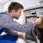 young professional fixing some electrical issue