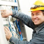 young professional checking electricity fitting