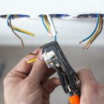 cropped picture of a person rewiring the house wire